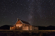 The Milky Way stretches across the sky above Mormon Row's Moulton Barn.