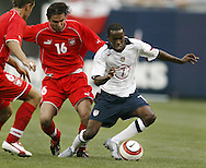 Soccer- USA vs Poland.USA's DaMarcus Beasley (7), right.