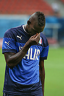 Mario Balotelli of Italy wipes his face during the Italy open training session at Arena da Amazonia, Manaus, Brazil<br /> Picture by Andrew Tobin/Focus Images Ltd +44 7710 761829<br /> 13/06/2014