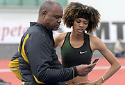 Apr 20, 2019; Torrance, CA, USA; Randall Cunningham (lfet) coaches his daughter Vashti Cunningham  during the women's high jump in the  61st Mt. San Antonio College Relays at El Camino College.
