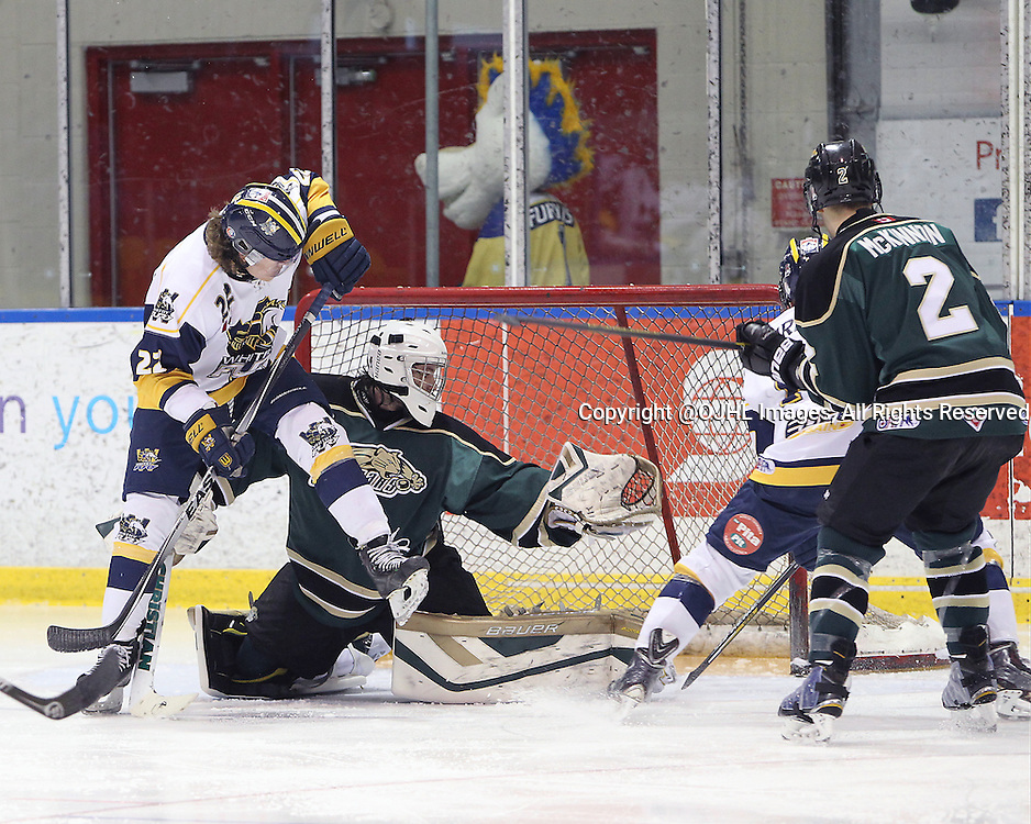 WHITBY, ON - Mar 1, 2015 : Ontario Junior Hockey League game action between the Whitby Fury and the Cobourg Cougars. Game two of the best of seven series. Tyler Lewis #1 of the Cobourg Cougars makes the save in the second period.<br /> (Photo by Tim Bates / OJHL Images)