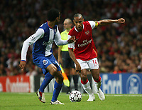 Photo: Chris Ratcliffe.<br /> Arsenal v FC Porto. UEFA Champions League, Group G. 26/09/2006.<br /> Thierry Henry of Arsenal clashes with Bosingwa of Porto.