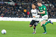 Duane Holmes (23) & Sam Hutchinson (23) during the EFL Sky Bet Championship match between Derby County and Sheffield Wednesday at the Pride Park, Derby, England on 11 December 2019.