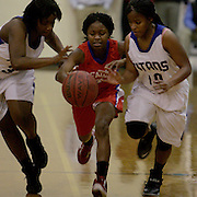Trask's Saniyah McCallister, left, and Jaleah Lee attempt to steal from Pender's Deja Burnett Tuesday night at Trask High School. (Jason A. Frizzelle)