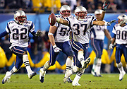 The New England Patriots celebrate after a fourth-quarter NcNabb interception to win Super Bowl XXXIX, their third in four years, at Alltel Stadium in Jacksonville, Fla. on Feb. 6, 2005. (Craig Litten)