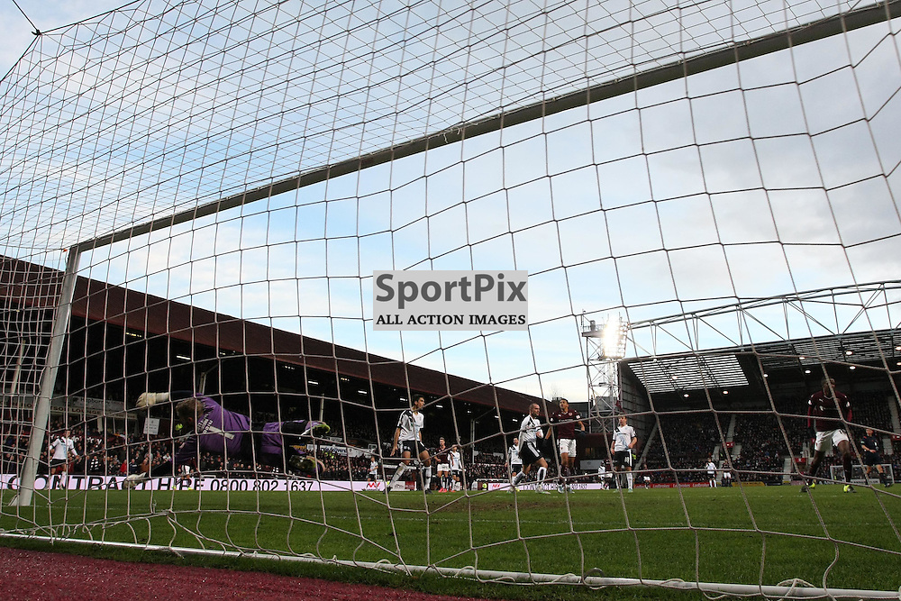 Arnauld Sutchuin of Hearts (far right) opens the scoring during the Ladbrokes Scottish Premiership match between Heart of Midlothian FC and Dundee FC at Tynecastle Stadium on November 21, 2015 in Edinburgh, Scotland. Photo by Jonathan Faulds/SportPix