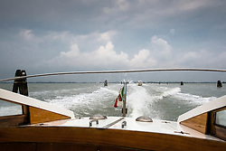 Taking a water taxi from Marco Polo Airport to Venice, Italy.<br /> Photo: Ed Maynard<br /> 07976 239803<br /> www.edmaynard.com