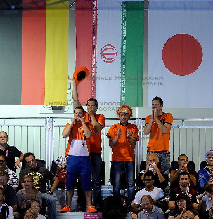 01-09-2012 ZITVOLLEYBAL: PARALYMPISCHE SPELEN 2012 ENGELAND - NEDERLAND: LONDEN<br /> In ExCel South Arena wint Nederland ook de tweede wedstrijd. Engeland werd met 3-0 verslagen / Dutch Oranje support publiek<br /> &copy;2012-FotoHoogendoorn.nl