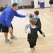 Pastor Donnie King Jr. works with Jackson Kellerman, left, and Landon Blacher before a Halo Basketball game Saturday December 20, 2014 at Grace United Methodist Church in Wilmington, N.C. (Jason A. Frizzelle)