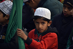 November 21, 2018 - Srinagar, Kashmir, India - Nov 21, 2018 - Srinagar, Jammu And Kashmir, India - Kashmiri Muslim young boy takes part in a religious procession during Eid-E-Milad, or the birth anniversary of Prophet Mohammad in Mir Shamasdin Iraqi R.A shrine situated in Srinagar, the summer capital of Indian controlled Kashmir. (Masrat Zahra/ NUR Photo) (Credit Image: © Masrat Jan/NurPhoto via ZUMA Press)