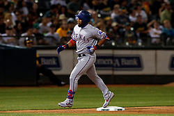 OAKLAND, CA - SEPTEMBER 21:  Elvis Andrus #1 of the Texas Rangers rounds the bases after hitting a home run against the Oakland Athletics during the sixth inning at the RingCentral Coliseum on September 21, 2019 in Oakland, California. The Oakland Athletics defeated the Texas Rangers 12-3. (Photo by Jason O. Watson/Getty Images) *** Local Caption *** Elvis Andrus