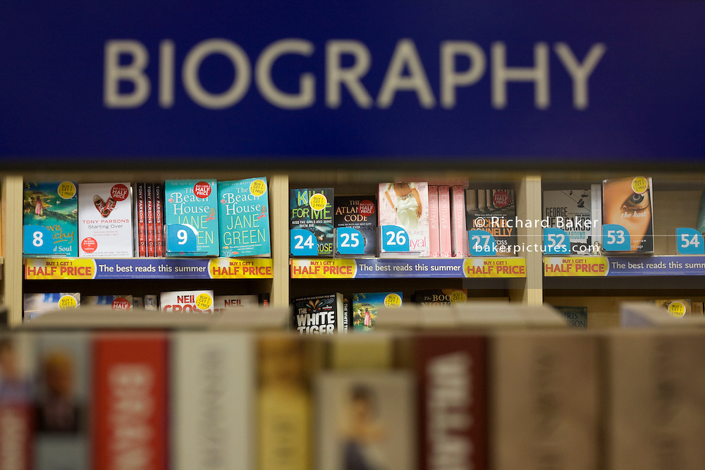 WH Smiths biographical literature on sale in departures shopping area of Heathrow airport's Terminal 5.