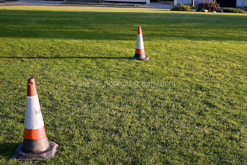 Parking cones used as goal posts in a suburban park field