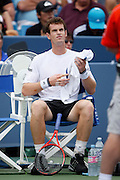 CINCINNATI, OH - AUGUST 22: Andy Murray of Great Britain rests in between games during his match with Roger Federer of Switzerland during day six of the Western & Southern Financial Group Masters on August 22, 2009 at the Lindner Family Tennis Center in Cincinnati, Ohio. Federer defeated Murray 6-2, 7-6. (Photo by Joe Robbins)