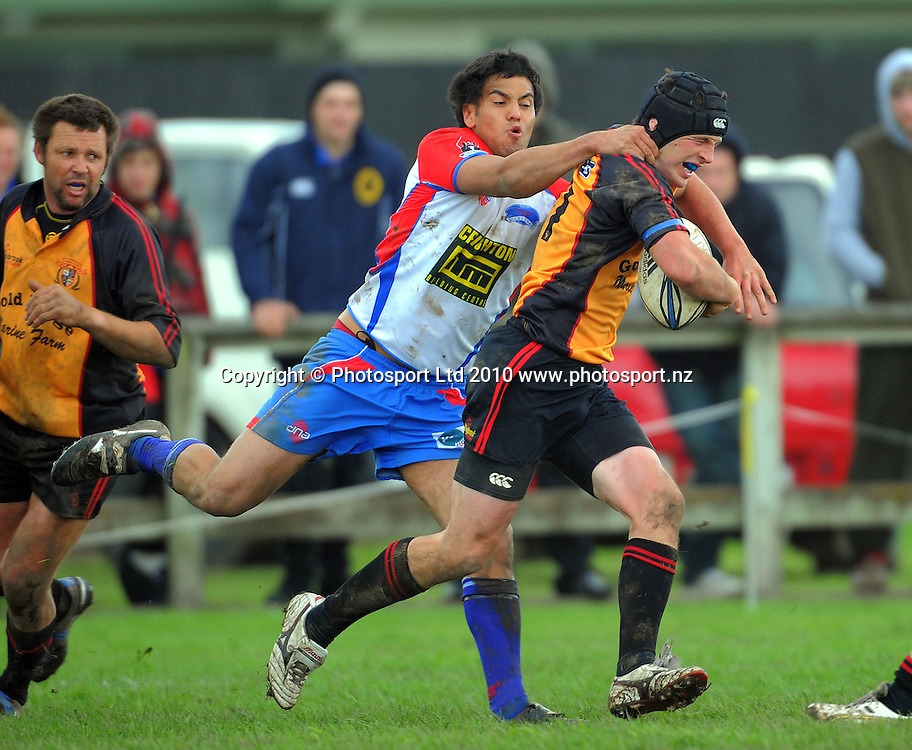 Ross Taurima tackles Thames Valley winger Jethro Meares. Heartland Championship rugby - Horowhenua Kapiti v Thames Valley at Easton Park, Foxton, New Zealand on Saturday, 18 September 2010. Photo: Dave Lintott/photosport.co.nz