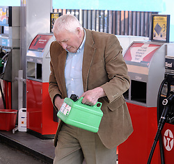 © Licensed to London News Pictures. 29/03/2012. Orpington, UK. A man filling a jerry can at a petrol station in Orpington, South London on March 29, 2012. Photo credit : Grant Falvey/LNP