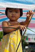 Mekong Delta. Phong Dien floating market. Girl on a boat.