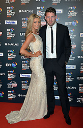 Pictured is Wales rugby player Alex Cuthbert and his partner.<br /> <br /> BT Sport Industry Awards 2014 at Battersea Evolution, London, UK.<br /> <br /> Thursday, 8th May 2014. Picture by Ben Stevens / i-Images