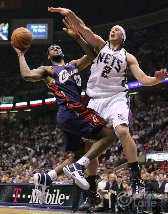 Cavaliers' LeBron James (L) shoots past the Nets' Josh Boone (R)during the first half of game 4 of the Eastern conference semifinals between the Cleveland Cavaliers and the New Jersey Nets at Continental Airlines Arena in East Rutherford, New Jersey on 14 May 2007.
