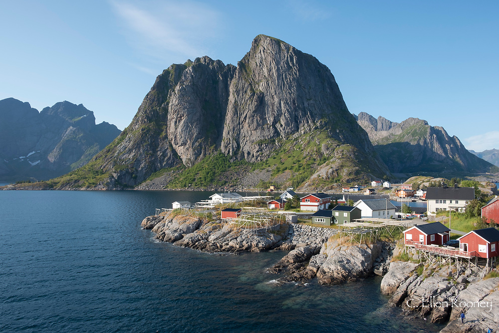 The old fishing village of Hamnoy where the rorbu (fishermen's huts) are now used for tourist accommodation backed by Festhelltinden Mountain.  Lofoten Islands, Norway, Scandanavia, Norway, Europe