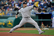 April 12, 2009:  Pitcher Joba Chamberlain #62 of the New York Yankees delivers a pitch against the Kansas City Royals at Kauffman Stadium in Kansas City, Missouri.  The Royals defeated the Yankees 6-4.