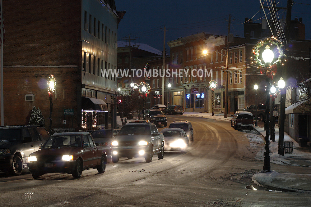 Middletown, NY - Cars drive down West Main Street at night after a winter storm on Dec. 2, 2007.