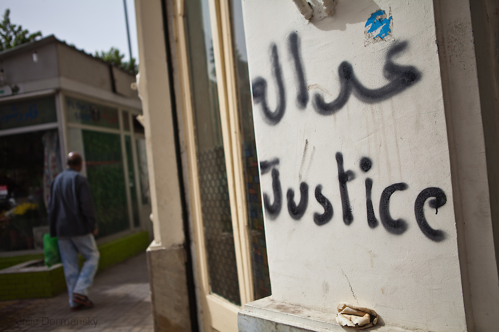 Graffiti calling for justice near Tahrir Square shortly after Mubark fell from power.