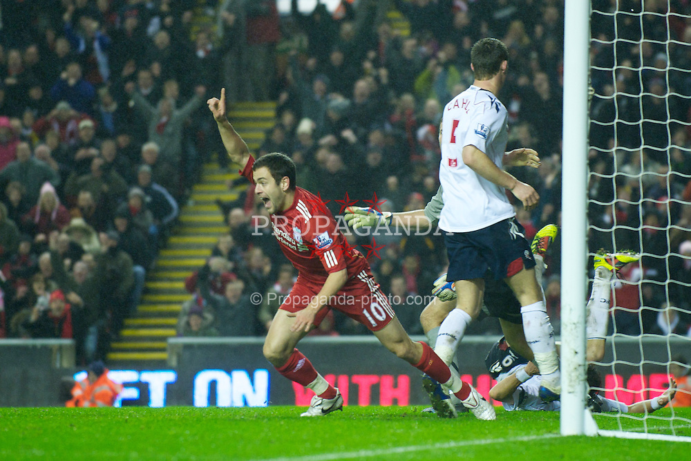 LIVERPOOL, ENGLAND - Saturday, January 1, 2011: Liverpool's Joe Cole celebrates scoring an injury time winning goal against Bolton Wanderers during the Premiership match at Anfield. (Photo by: David Rawcliffe/Propaganda)