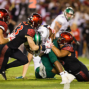 22 September 2018: San Diego State Aztecs safety Parker Baldwin (33) and linebacker Ronley Lakalaka (39) tackle Eastern Michigan Eagles running back Shaq Vann (5) for a loss in the second quarter. The San Diego State Aztecs beat the Eastern Michigan Eagles 23-20 in over time at SDCCU Stadium in San Diego, California.