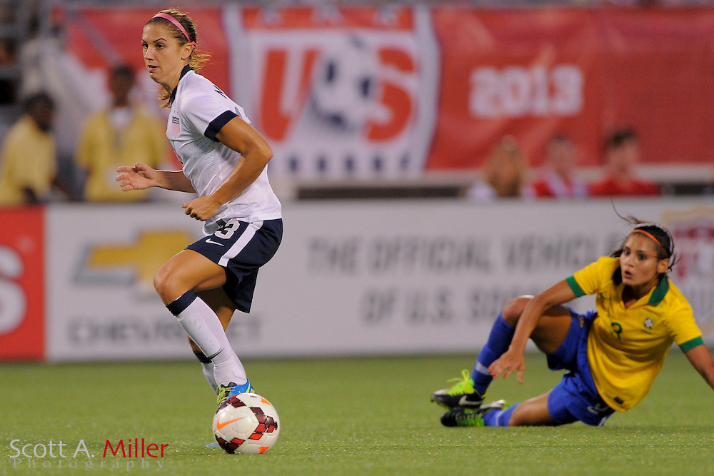 U.S. forward Alex Morgan (13) in action during the United States' 4-1 win over Brazil in an international friendly at the Florida Citrus Bowl on Nov. 10, 2013 in Orlando, Florida. <br /> <br /> &copy;2013 Scott A. Miller