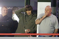 LIVERPOOL, ENGLAND - Thursday, September 16, 2010: Pop-Group Oasis' frontman and Manchester City supporter Liam Gallagher sees Liverpool take on FC Steaua Bucuresti alongside George Cole, father of Liverpool's Joe Cole during the opening UEFA Europa League Group K match at Anfield. (Photo by David Rawcliffe/Propaganda)