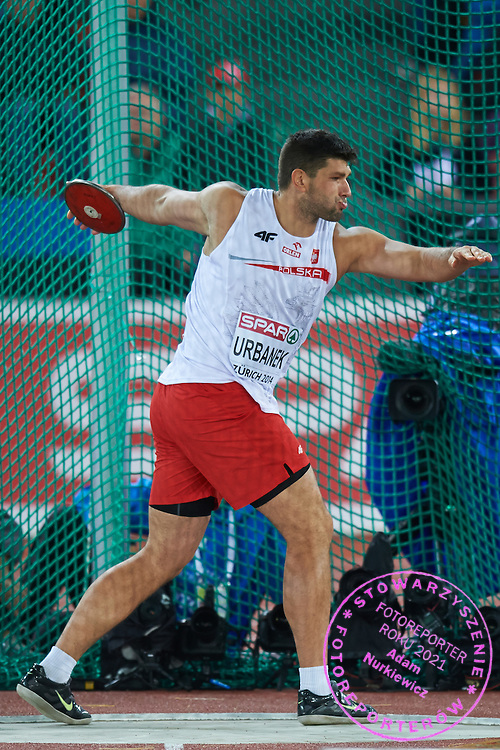 Robert Urbanek from Poland competes in men's discus throw final during the Second Day of the European Athletics Championships Zurich 2014 at Letzigrund Stadium in Zurich, Switzerland.<br /> <br /> Switzerland, Zurich, August 13, 2014<br /> <br /> Picture also available in RAW (NEF) or TIFF format on special request.<br /> <br /> For editorial use only. Any commercial or promotional use requires permission.<br /> <br /> Photo by &copy; Adam Nurkiewicz / Mediasport