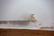 Waves cresting over Folkstone Harbour Arm, Folkestone, Kent on the south coast of England,  Sunday February 9, 2020, as Storm Ciara swept over the United Kingdom. Amber weather warnings were put into place by the MET office as gusts of up to 90mph and heavy rain swept across the UK. An amber warning from the MET office expects a powerful storm that will disrupt air, rail and sea links travel, cancel sports events, cut electrical power and damage property.  (photo by Andrew Aitchison / In pictures via Getty Images)