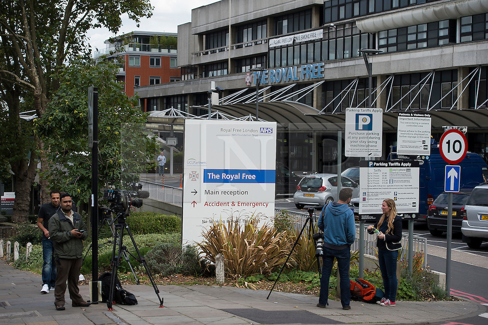 © London News Pictures. 24/08/2014. London, UK. Media outside the Royal Free Hospital in North London where a British man who has contracted the Ebola virus is expected to be treated. The British healthcare worker who contracted the virus while working in in Sierra Leone is  being flown back to the UK on an RAF jet through RAF Northolt base. Photo credit : Ben Cawthra/LNP