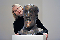 "© Licensed to London News Pictures. 17/11/2017. London, UK.  London, UK.  17 November 2017.  A staff member views ""Head"", circa 1968, by Dame Elisabeth Frink (Est. GBP 80-120k). Preview upcoming auctions of Modern & Post War British Art and Scottish Art taking place at Sotheby's, New Bond Street, on 21 and 22 November. Photo credit: Stephen Chung/LNP"