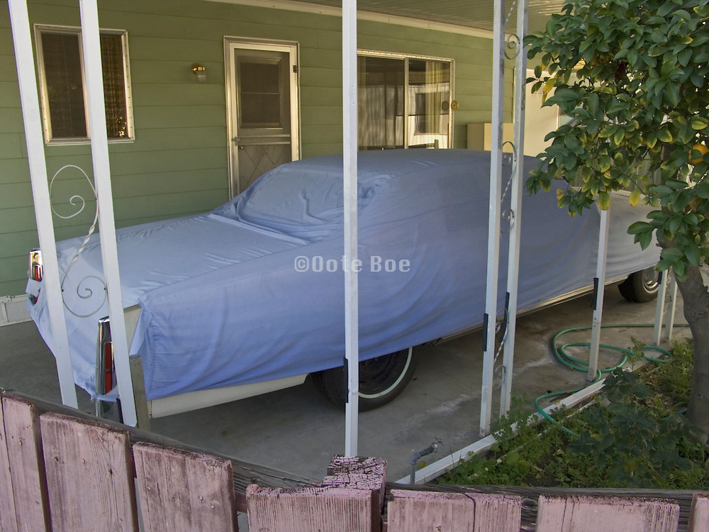 covered car parked in driveway