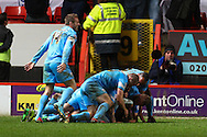 Thomas Kennedy of Barnsley (on floor) celebrates scoring his team's second goal to make it 0-2, with team mates, during the Sky Bet Championship match at The Valley, London<br /> Picture by David Horn/Focus Images Ltd +44 7545 970036<br /> 15/04/2014