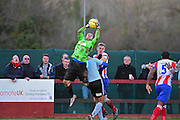 Dorking Wanderers Slalomer Huk takes a high ball during the Ryman League - Div One South match between Dorking Wanderers and Lewes FC at Westhumble Playing Fields, Dorking, United Kingdom on 28 January 2017. Photo by Jon Bromley.