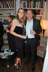 GRANIA STEPHENSON and FABIEN PICTET at a dinner hosted by Marlon and Nadya Abela in aid of Kids Company at Morton's, Berkeley Square, London on 25th September 2012.