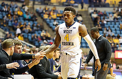Dec 16, 2017; Morgantown, WV, USA; West Virginia Mountaineers guard Daxter Miles Jr. (4) greets teammates along the bench during the first half against the Wheeling Jesuit Cardinals at WVU Coliseum. Mandatory Credit: Ben Queen-USA TODAY Sports