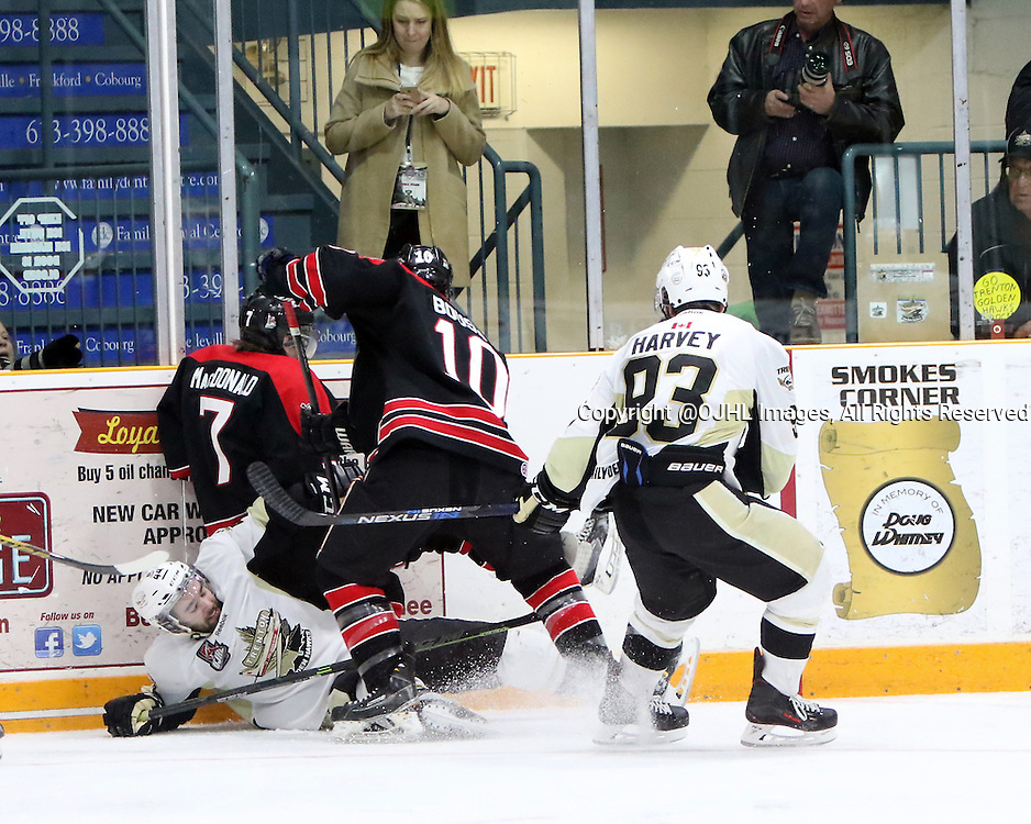 TRENTON, ON - Apr 18, 2016 -  Ontario Junior Hockey League game action between Trenton Golden Hawks and the Georgetown Raiders. Game 3 of the Buckland Cup Championship Series, at the Duncan Memorial Gardens in Trenton, Ontario. Michael Boushy #10 of the Georgetown Raiders makes the hit during the second period<br /> (Photo by Ed McPherson / OJHL Images)
