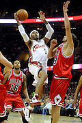 Apr 19, 2010; Cleveland, OH, USA; Cleveland Cavaliers guard Mo Williams (2) shoots over Chicago Bulls center Joakim Noah (13) during the first period in game two in the first round of the 2010 NBA playoffs at Quicken Loans Arena. Mandatory Credit: Jason Miller-US PRESSWIRE
