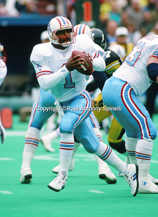 Houston Oilers quarterback Warren Moon (1) drops back to pass during the NFL football game against the Pittsburgh Steelers on Nov. 1, 1992 in Pittsburgh. The Steelers won the game 21-20. (©Paul Anthony Spinelli)