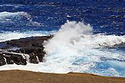The waves break over the rocks at Makapu'U Beach.