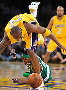 Kobe Bryant trips over the top of Rajon Rondo while going for a loose ball in the first half. The Lakers defeated the Boston Celtics in game 7 of the NBA Finals  83-79 in Los Angeles, CA 06/16/2010 (John McCoy/Staff Photographer).