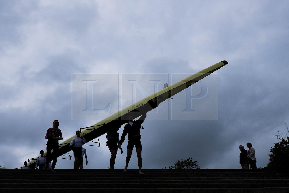 &copy; Licensed to London News Pictures.13/06/15<br /> Durham, England<br /> <br /> A rowing crew walk their boat to the water during the 182nd Durham Regatta rowing event held on the River Wear. The origins of the regatta date back  to commemorations marking victory at the Battle of Waterloo in 1815. This is the second oldest event of this type in the country and attracts over 2000 competitors from across the country.<br /> <br /> Photo credit : Ian Forsyth/LNP