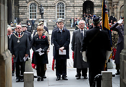 (Left to right) Edinburgh Lord Provost Frank Ross, First Minister Nicola Sturgeon, presiding officer of the Scottish Parliament Ken Macintosh and Advocate General Lord Keen during a two minute silence at the Stone of Remembrance at the City Chambers, Edinburgh, on the 100th anniversary of the signing of the Armistice which marked the end of the First World War.