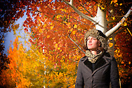 Young woman enjoying the autumn sun in front of trees in Bend,Oregon,USA<br />