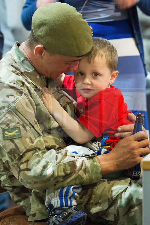 © Licensed to London News Pictures . 25/04/2013. Catterick Barracks , North Yorkshire , UK . Stephen Rumble (Dad , 26) hugs son Stephen Rumble Jnr (2) (from Liverpool) . Soldiers from the 1st Battalion , the Duke of Lancaster's Regiment (1 Lancs) arrive at Catterick Barracks to be greeted by their families this evening (Thursday 25th April), following a six month tour in Lashkar Gah , Helmand Province , Afghanistan . With the UK combat mission due to complete by the end of 2014 , this is likely to be the last deployment by 1 Lancs in Afghanistan , the British Army reports . Photo credit : Joel Goodman/LNP
