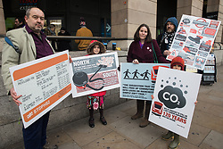 London, UK. 22 January, 2020. Campaigners seeking to protect ancient woodland and wildlife threatened by the HS2 high-speed rail link, including Stop HS2 Campaign Manager Joe Rukin (l) and author of 'The Empowered Entrepreneur' and Extinction Rebellion member Elizabeth Cairns (c), arrive in Westminster to lobby their MPs to speak out against and push for an immediate halt to works for the huge infrastructure project. Cost projections for the project, which would destroy or irreparably damage 108 ancient woodlands, are reported to have risen to £106bn and the Government is expected to make a decision about its viability in February.